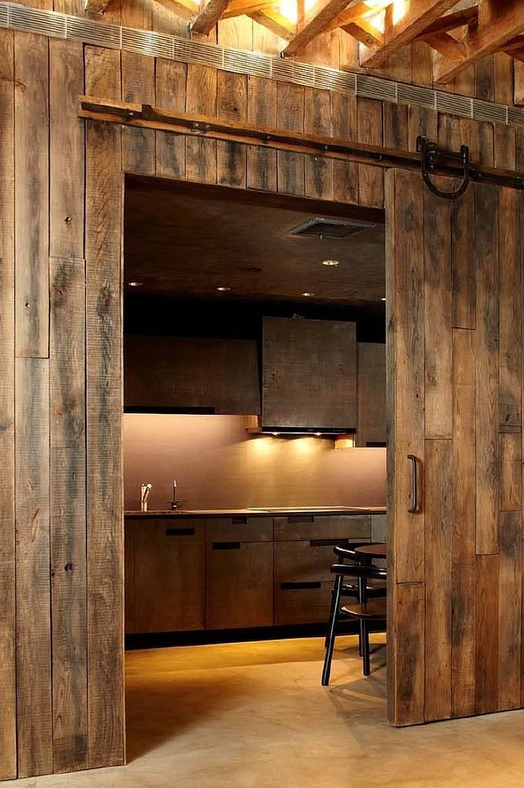 barn-doors-leading-to-the-kitchen-give-it-a-rustic-appeal-instantly