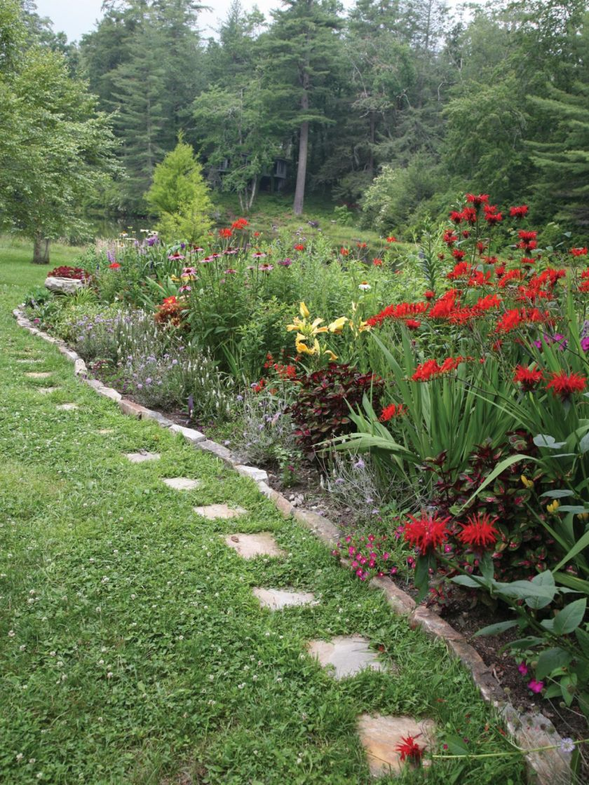 ci-lifelong-landscape-design-pg018_red-and-mixed-medley-of-flowers_3x4-jpg-rend-hgtvcom-1280-1707