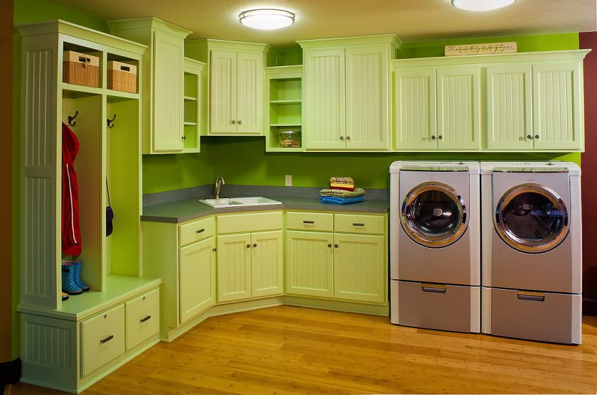 kitchens-painted-simple-and-modern-kitchen-decor-ideas-come-with-pale-green-color-accent-kitchen-cabinet-on-lime-green-kitchen-becksplash-also-glossy-surface-wooden-floor-plus-laundry-zone-idea