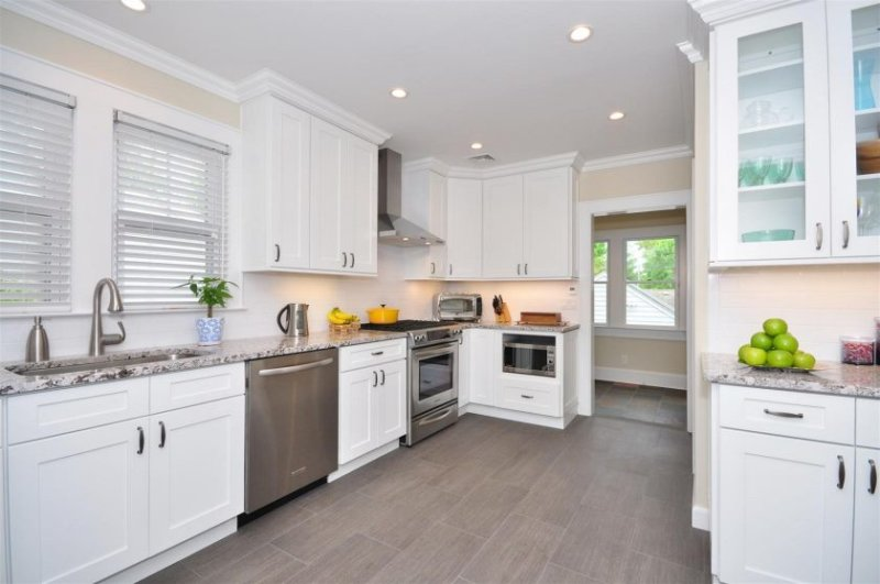 off-white-kitchen-cabinets-with-granite-countertops