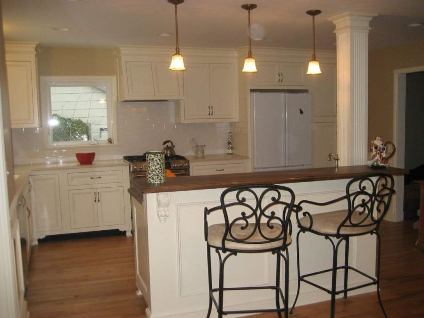 terrific-wrought-iron-bar-stools-with-white-pad-on-catchy-country-white-kitchen-design-plus-antique-hanging-lamps