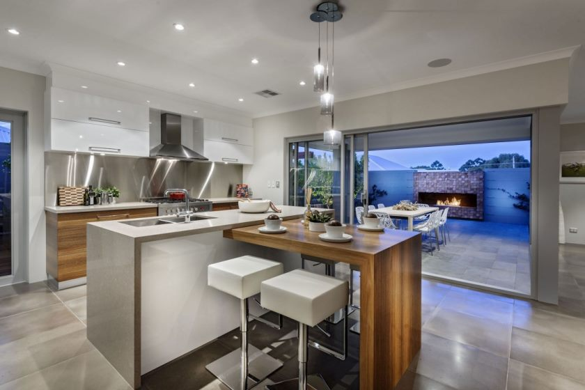appealing-white-gloss-wooden-kitchen-island-with-beige-wooden-top-connected-by-brown-varnishes-mahogany-wood-bar-table-under-beautiful-glass-hanging-lamps-1120x746