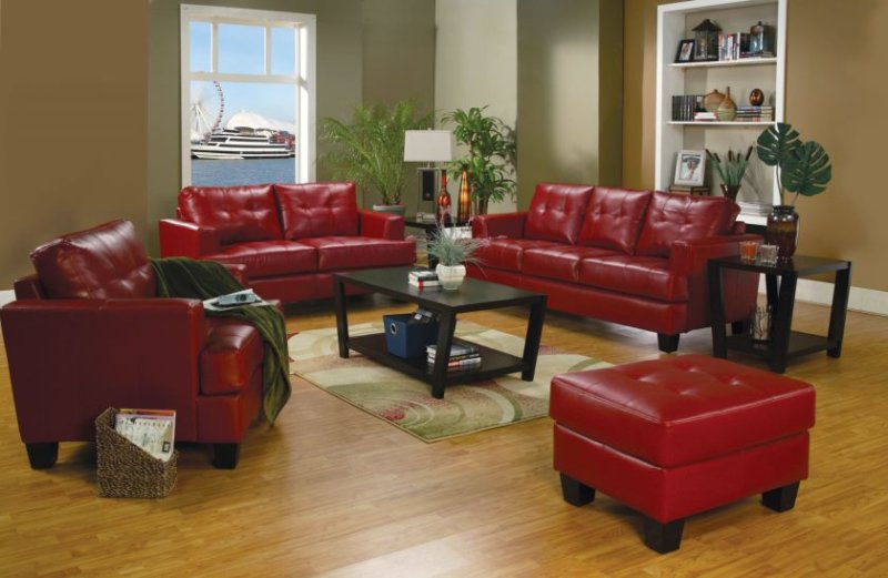 living-room-red-leather-sofa-with-ottoman-for-small-living-room-spaces-with-black-wooden-table-with-bookshelf-and-laminate-wooden-floor-tiles-ideas-leather-living