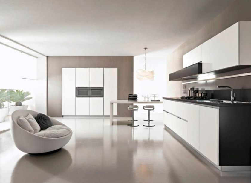 modern-open-kitchen-design-with-italian-white-cabinets-and-black-countertop-in-front-of-white-round-sofa