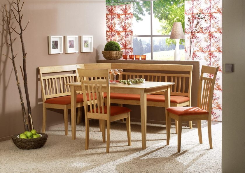 small-kitchen-table-with-corner-cushioned-bench-in-orange-color-and-two-armless-chairs