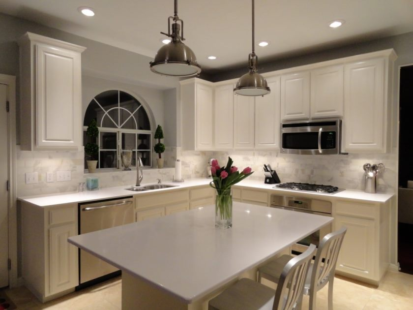 vintage-kitchen-ikea-white-quartz-countertops-kitchen-calacatta-marble-subway-tile-backsplash-satin-nickel-pendant-lighting-white-slat-back-counter-stools