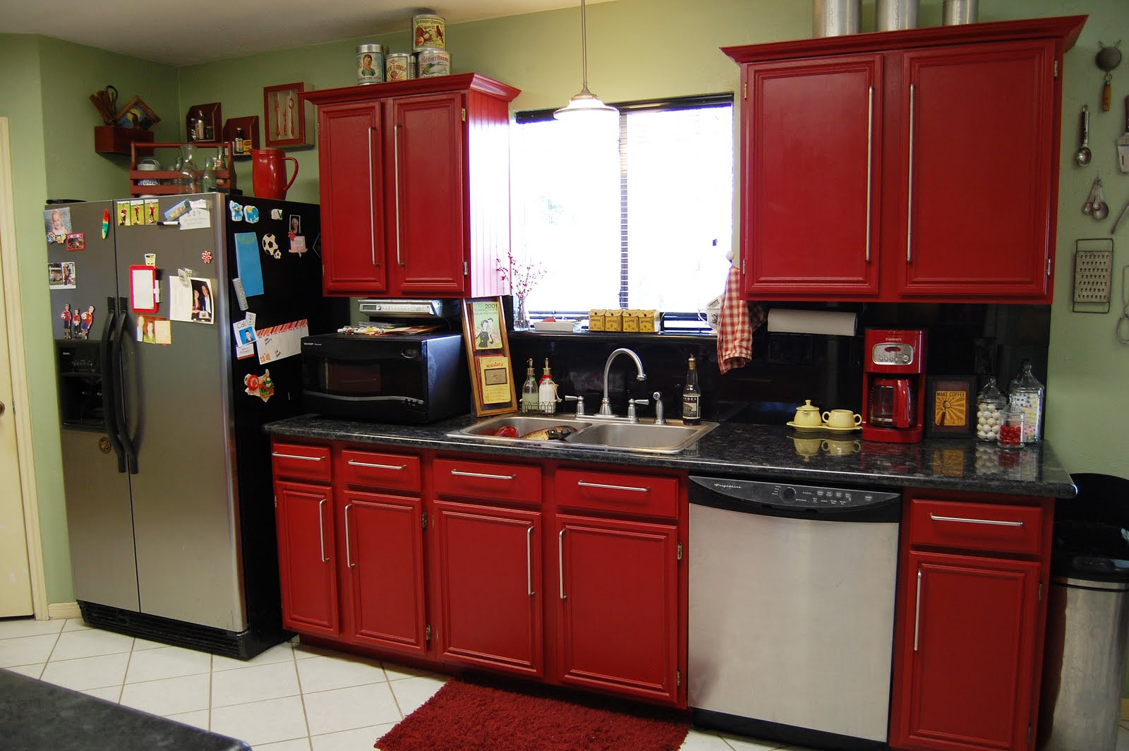 attractive-kitchen-furniture-with-red-kitchen-cabinet-between-small-window-on-calm-wall