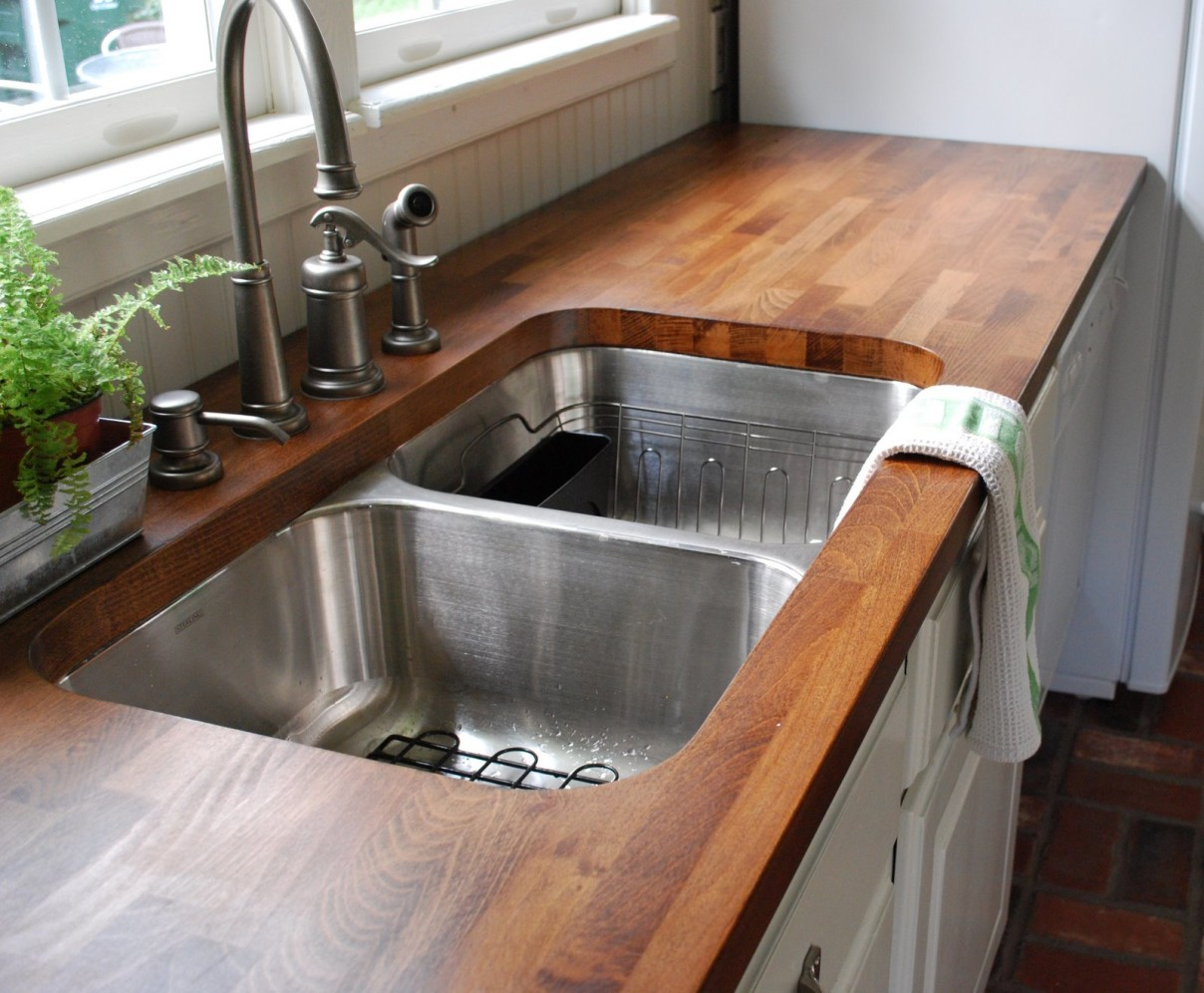 awesome-wooden-countertop-installed-at-contemporary-kitchen-equipped-with-kitchen-sink-shapes-and-curved-faucet-made-of-metal-near-with-chic-vase-1208x996