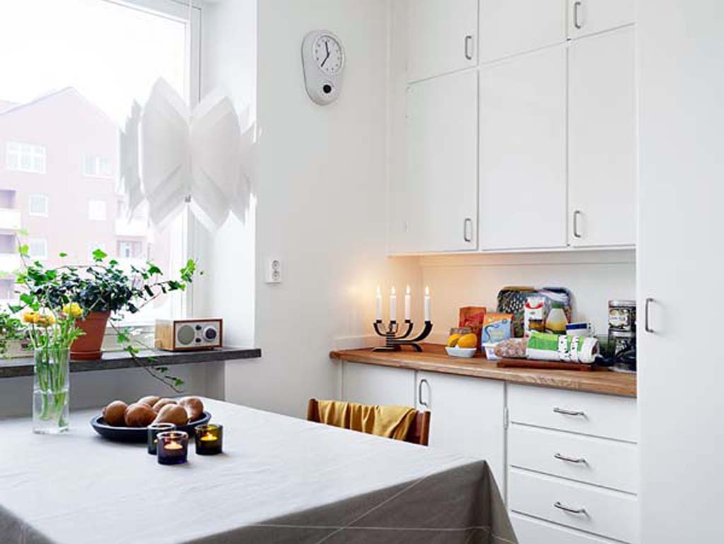 bright-white-themed-kitchen-designed-in-apartment-interior-design-furnished-with-modern-kitchen-furniture