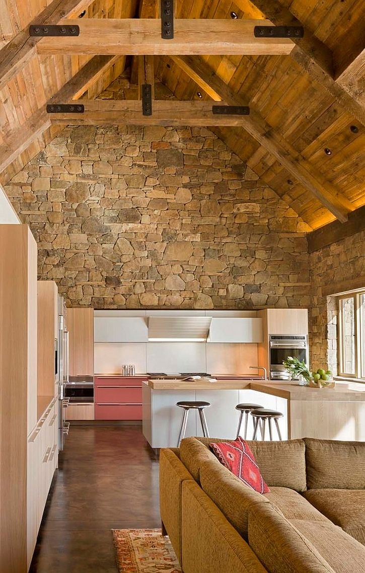 contemporary-island-in-white-and-cabinets-combined-with-a-captivating-rustic-backdrop-in-the-kitchen