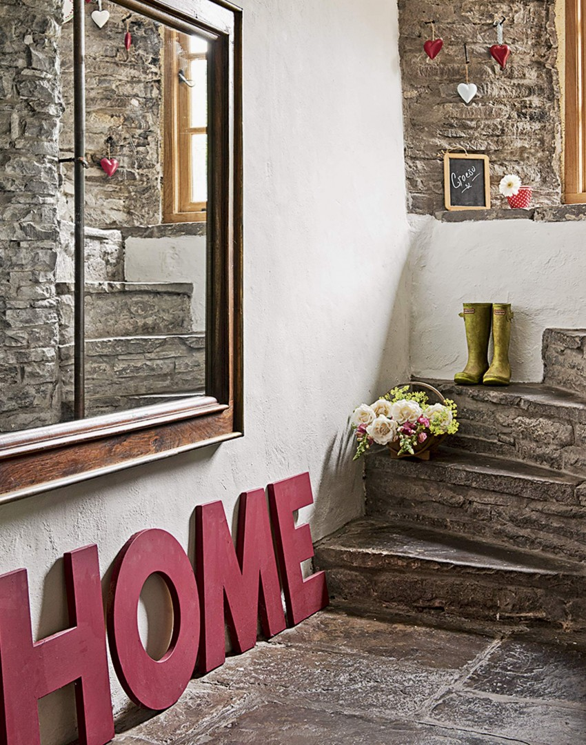 country-hallway-with-flagstone-floor-and-stone-steps