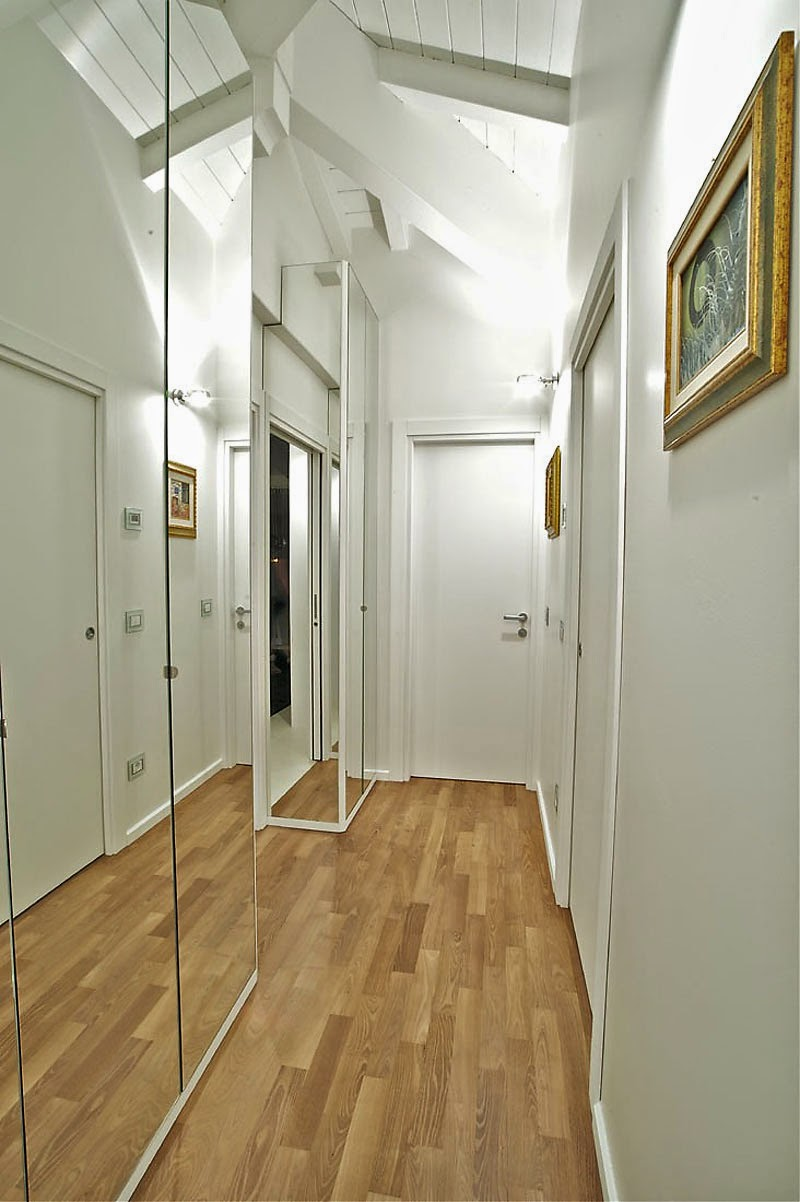 exclusive-alley-space-in-penthouse-fabio-gianoli-interior-finished-with-frameless-mirror-design-with-wooden-flooring