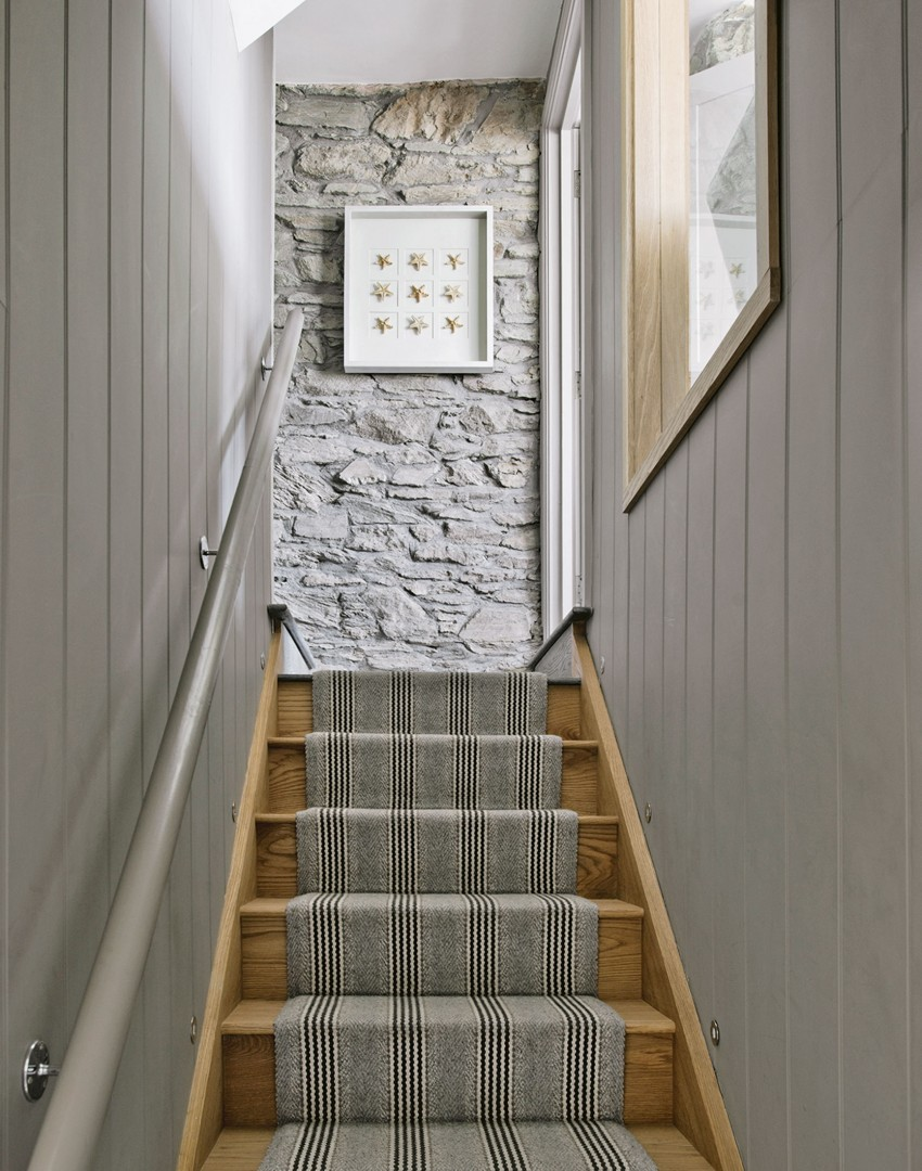 grey-staircase-with-exposed-brick-wall-and-stair-runner