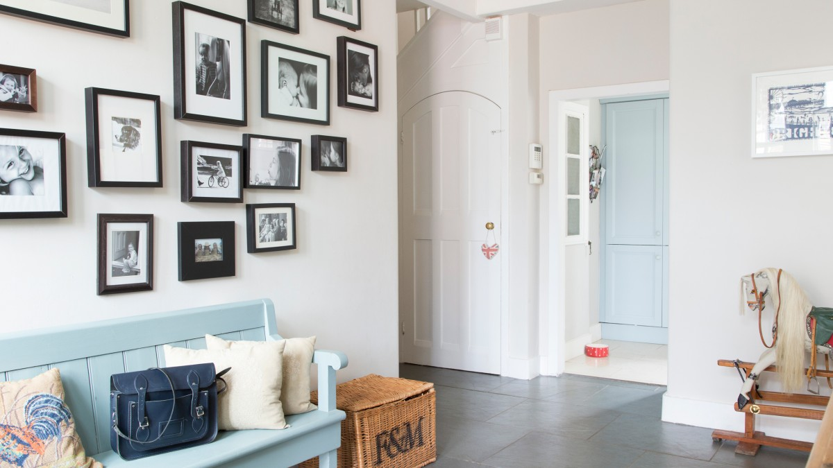 hallway-with-painted-bench-and-family-photo-wall