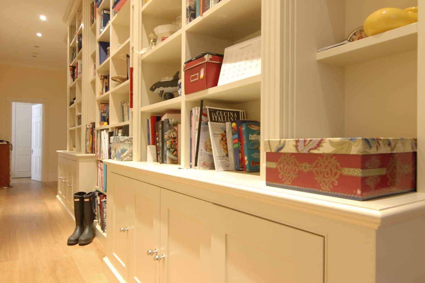 large-bespoke-hallway-library-with-storage-cupboards-2
