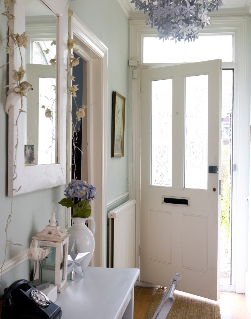 pale-green-hallway-with-silver-floral-chandelier
