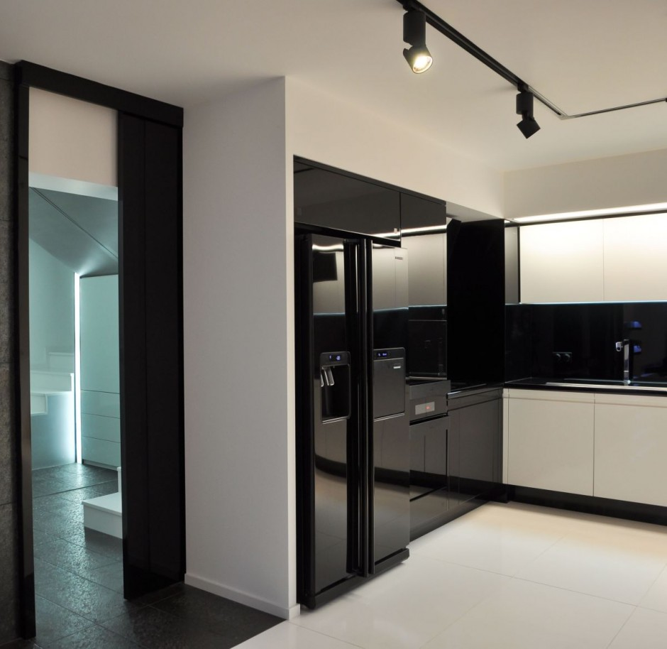 a-kitchen-with-white-floor-is-also-a-storage-closet-black-cookware-then-sink-the-right-side-and-then-the-lights-above-the-kitchen