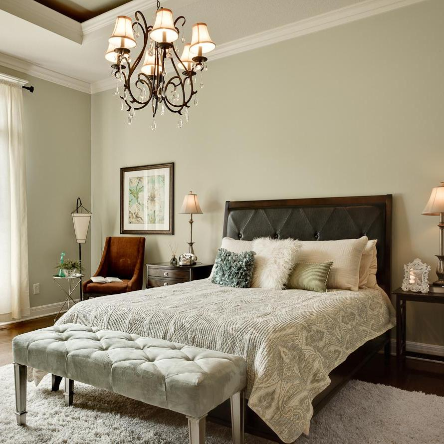adorable-chandelier-for-bedroom-design-with-white-fur-rug-on-wooden-floor-plus-chair-beside-bed-and-gray-painting-wall-also-brown-chair-corner