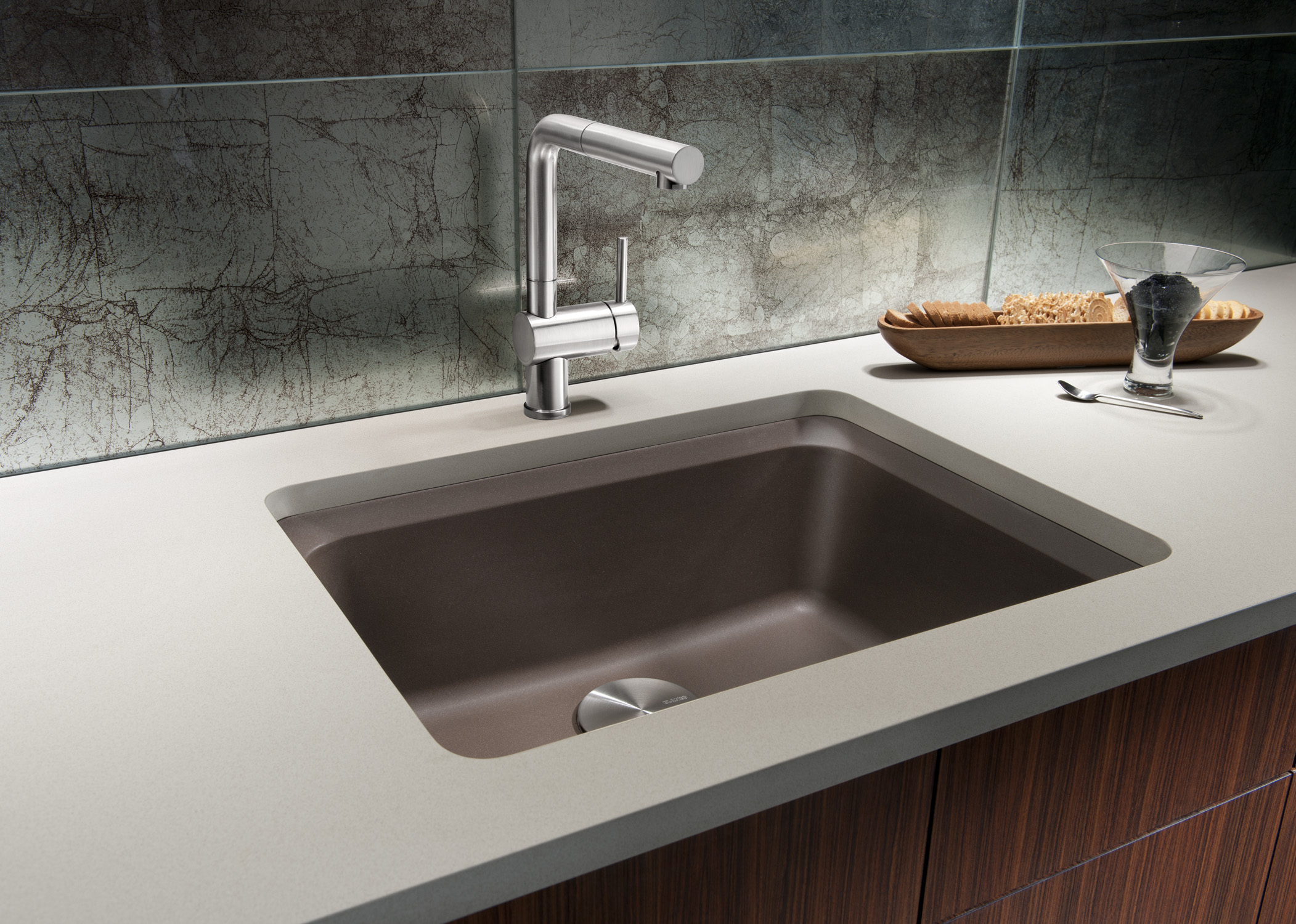 architecture-modern-design-ideas-kitchen-sinks-with-white-granite-countertop-and-marble-backsplash-also-brown-wooden-drawers-and-brightes-lighting-kitchen-sink-ideas