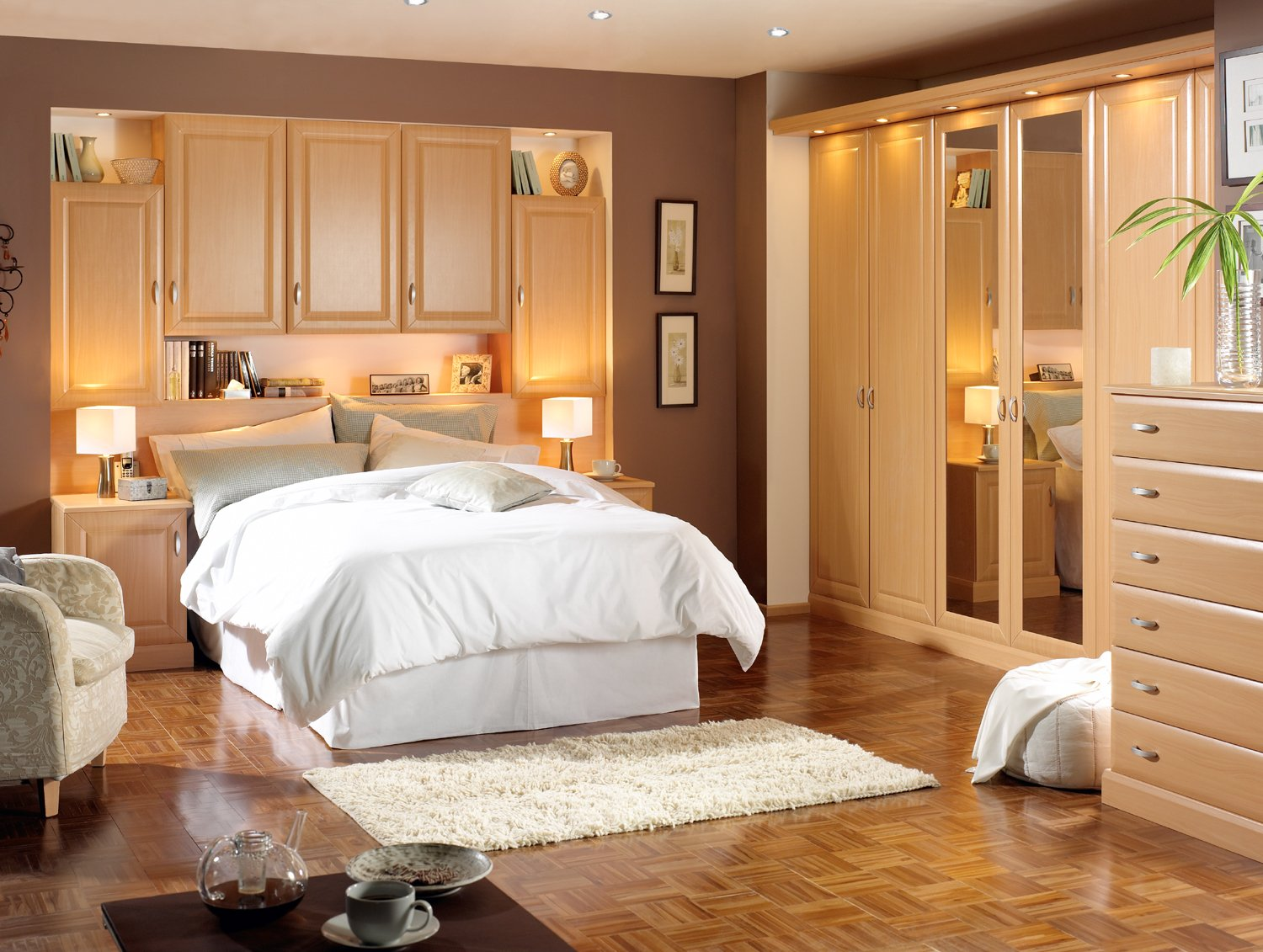 beige-bedroom-design-featuring-delectable-wood-closet-furniture-units-with-mirror-also-completed-with-bed-cabinets-storager-over-white-bedsheets-paired-with-sofa-units