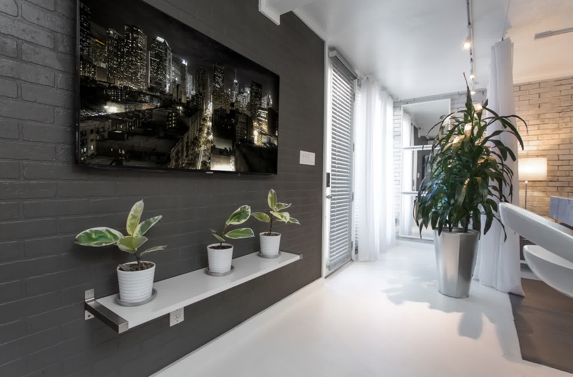 captivating-hallway-decoration-with-rectangular-lcd-tv-mounted-on-dark-tiles-wall-unify-plant-pot-attached-in-floating-shelves-featuring-big-silver-flowers-incorporates-slick-flooring-ideas-awesome-ga