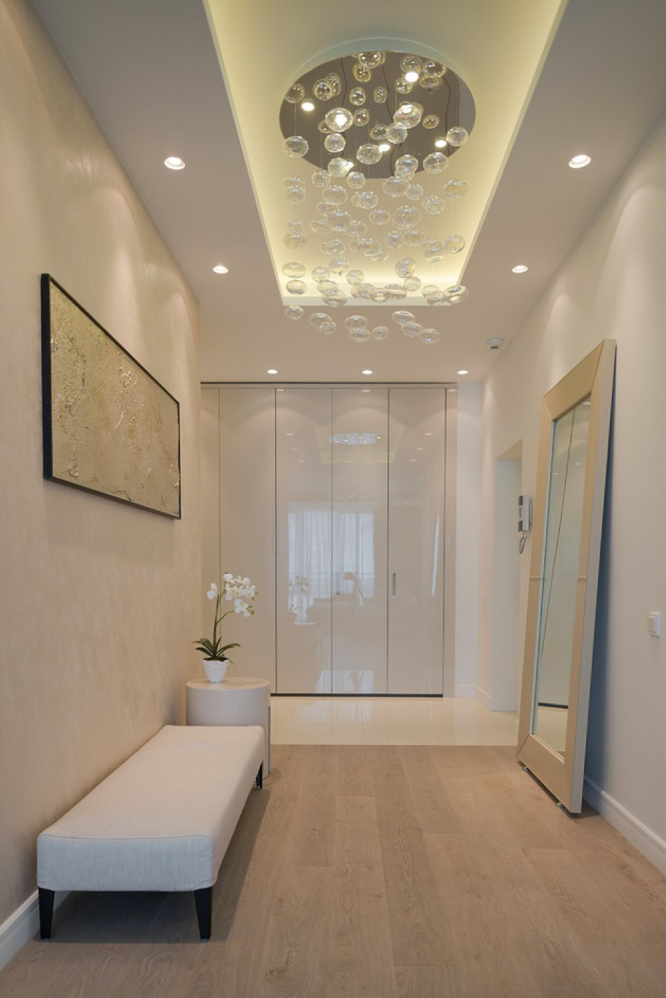 comfortable-long-upholstered-bench-plus-rectangular-floor-length-mirror-and-contemporary-hallway-lighting-ideas-and-small-flower-decor