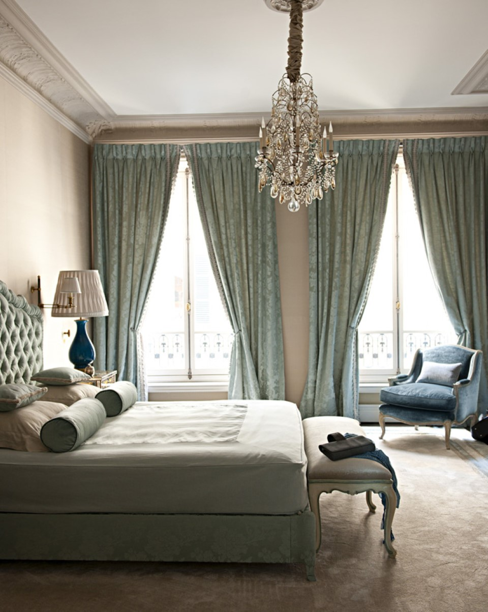 contemporary-teal-bedroom-set-with-small-crystal-chandelier-plus-decorative-black-bergere