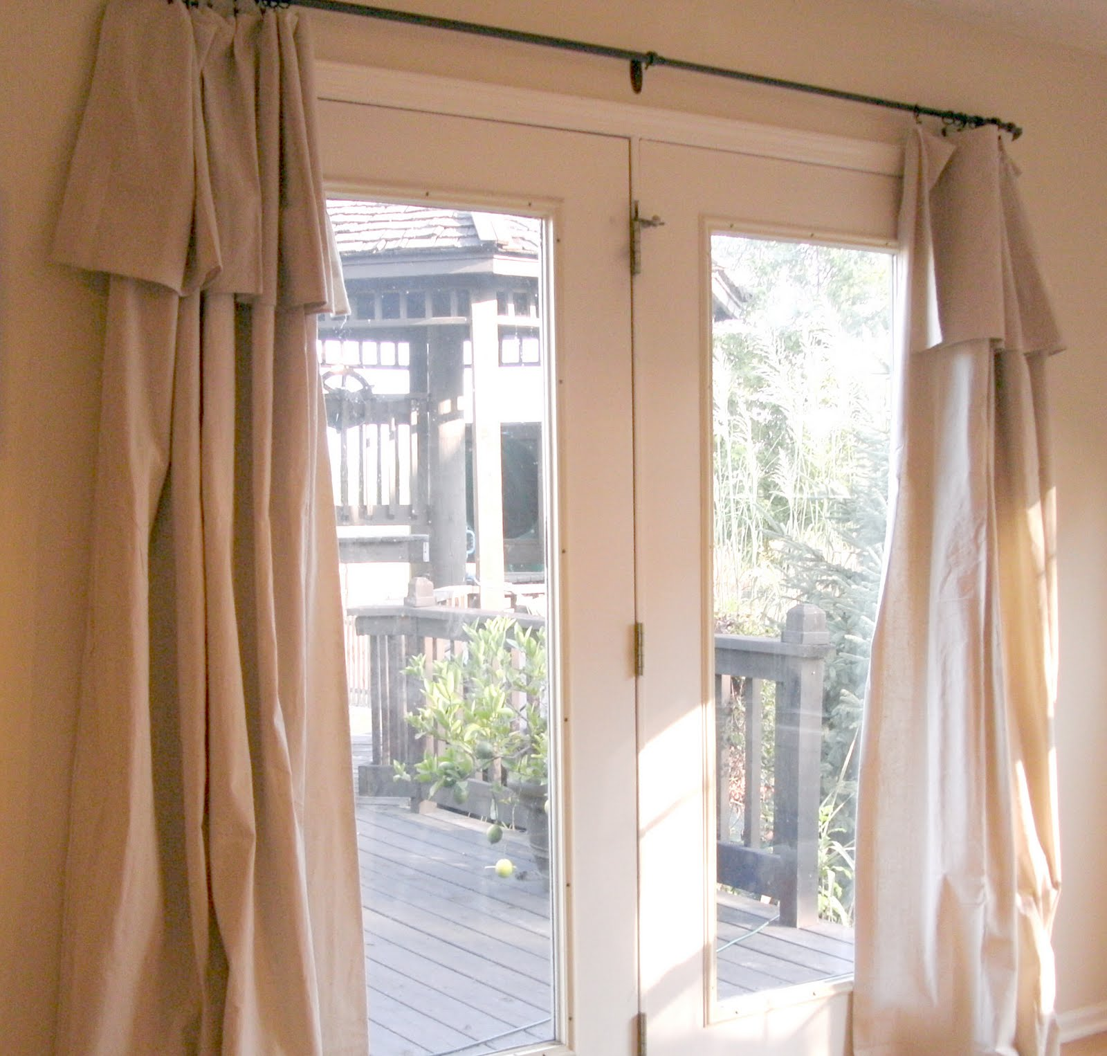 decoration-dazzling-neutral-fabric-double-patio-door-curtains-for-swing-glass-front-door-and-small-railing-bar-in-modern-cheap-budget-door-treatment-ideas-exemplary-patio-door-curtains-decoration-idea
