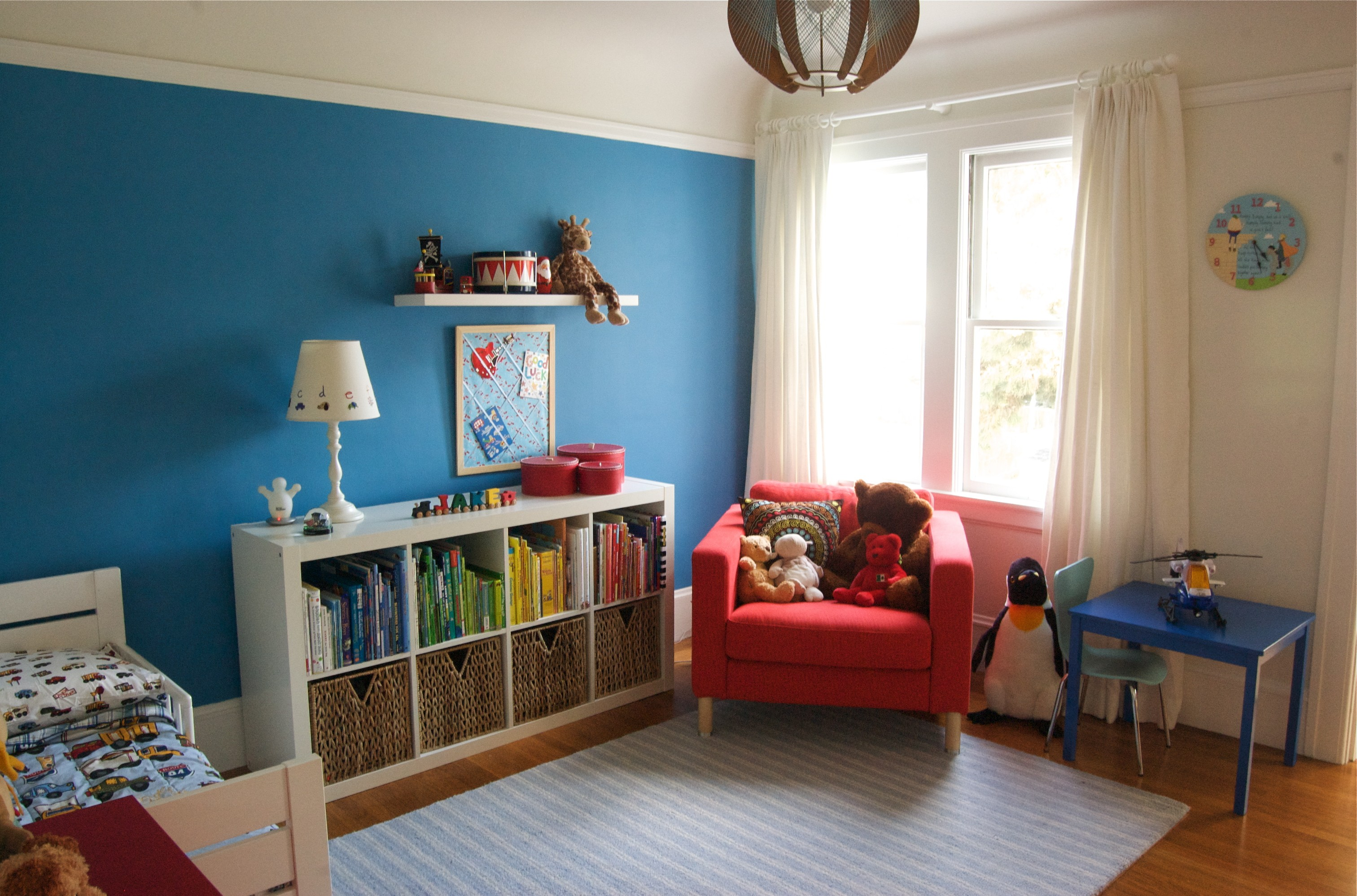 enchanting-diy-home-decor-ideas-toddler-boy-rooms-design-with-white-bed-along-white-book-shelves-and-white-table-lamp-also-red-sofa-chair-near-blue-table-plus-white-glass-window-and-white-curtain-as-w