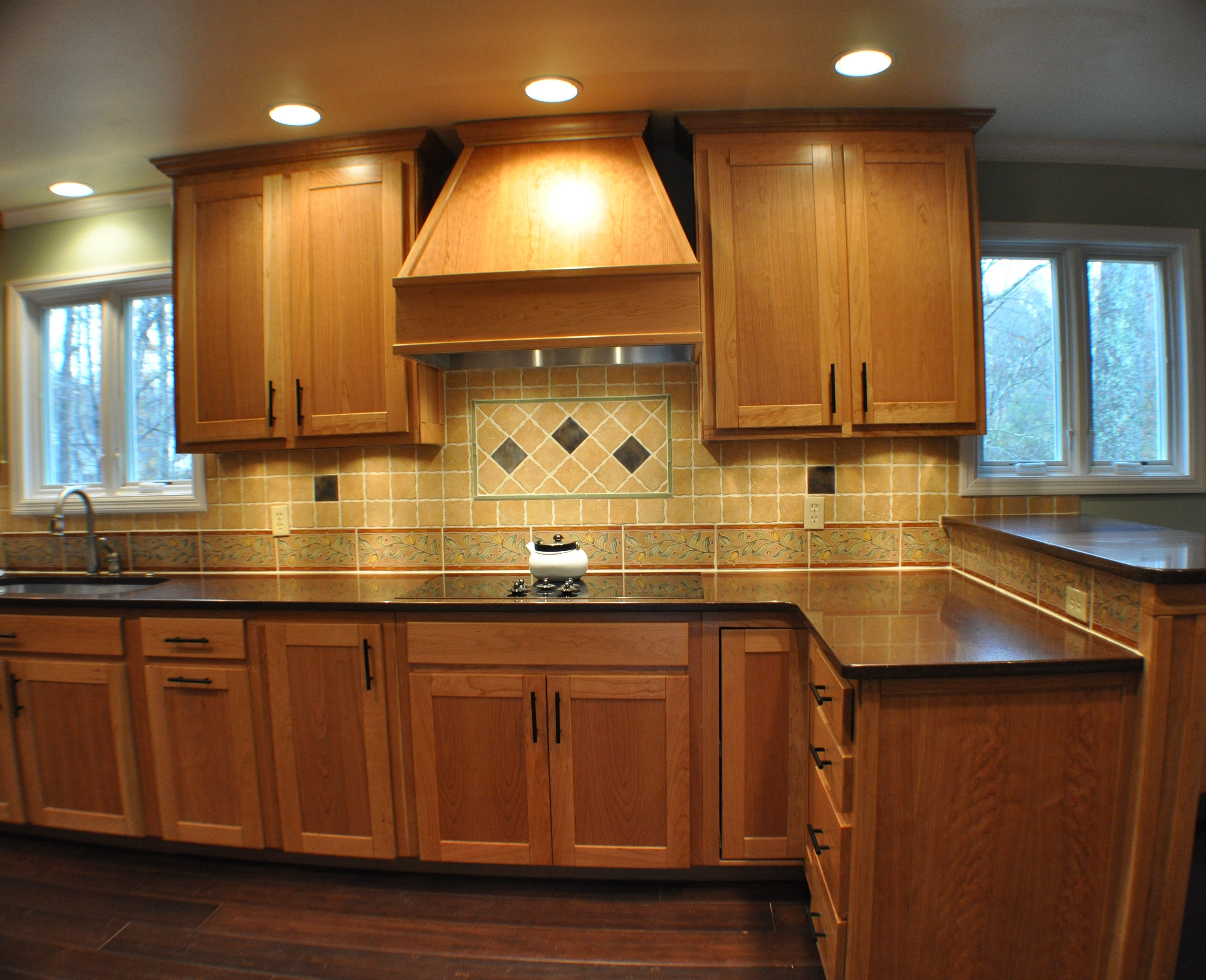 fabulous-design-ideas-of-traditional-kitchen-with-brown-wooden-kitchen-cabinets-and-black-granite-countertop-also-double-door-wall-mounted-wooden-kitchen-cabinets-also-brown-color-tiles-backsplash-and
