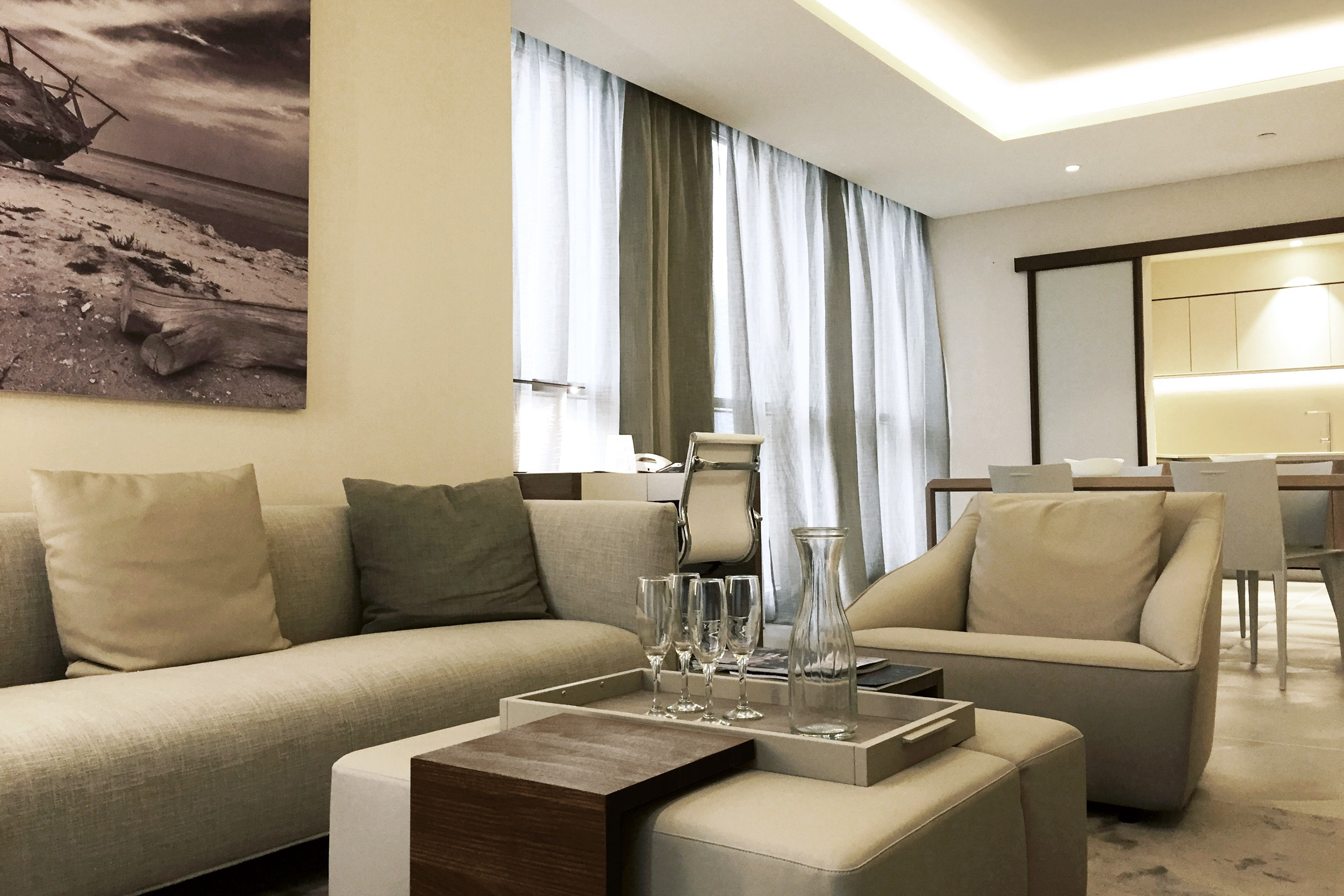 fascinating-best-interior-design-site-with-walls-painted-of-cream-plus-brown-curtains-on-glass-windows-also-grey-fabric-sofa-and-cream-fabric-coffee-table-with-grey-wooden-top-along-cream-color-vinyl