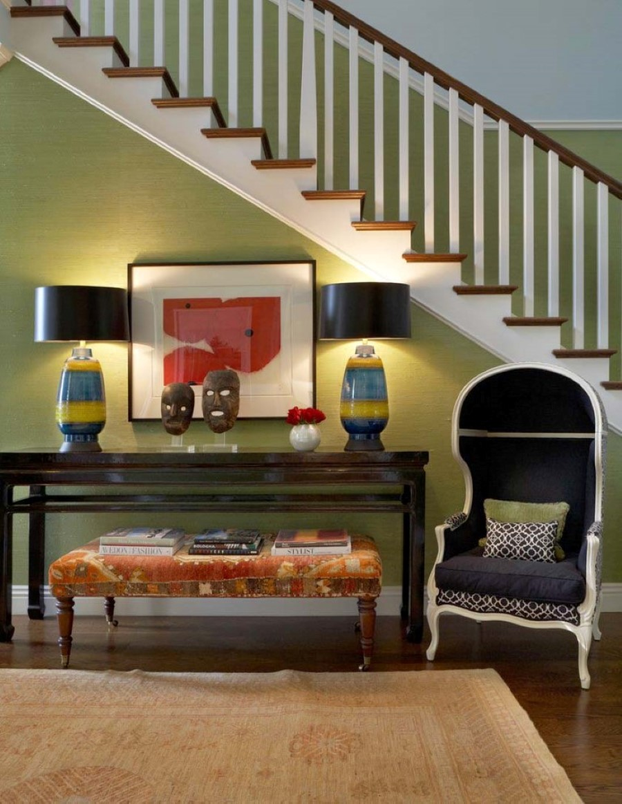 gothic-black-armchair-and-side-table-under-staircase-paired-with-unique-decorative-table-lamps-also-green-wall-paint-color-background