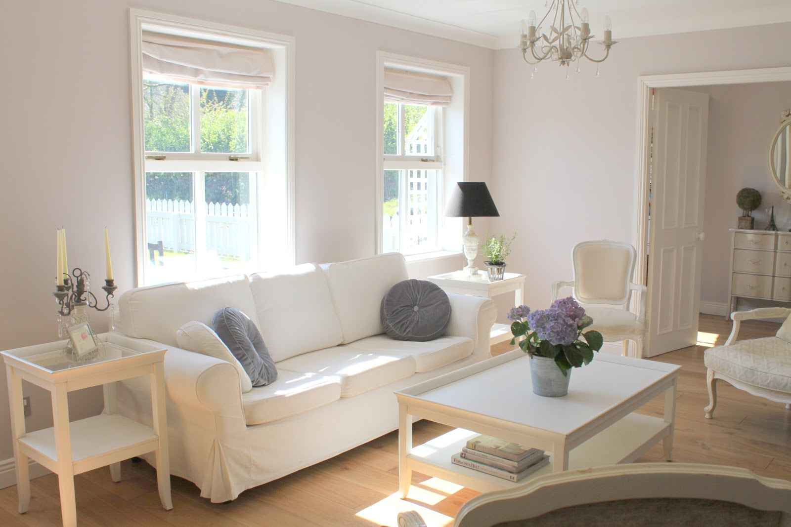 ikea-living-room-decorating-ideas-in-a-small-space-with-a-long-white-sofa-and-white-table-plus-a-vase-then-left-and-the-candle-lights-a-lamp-left-corner