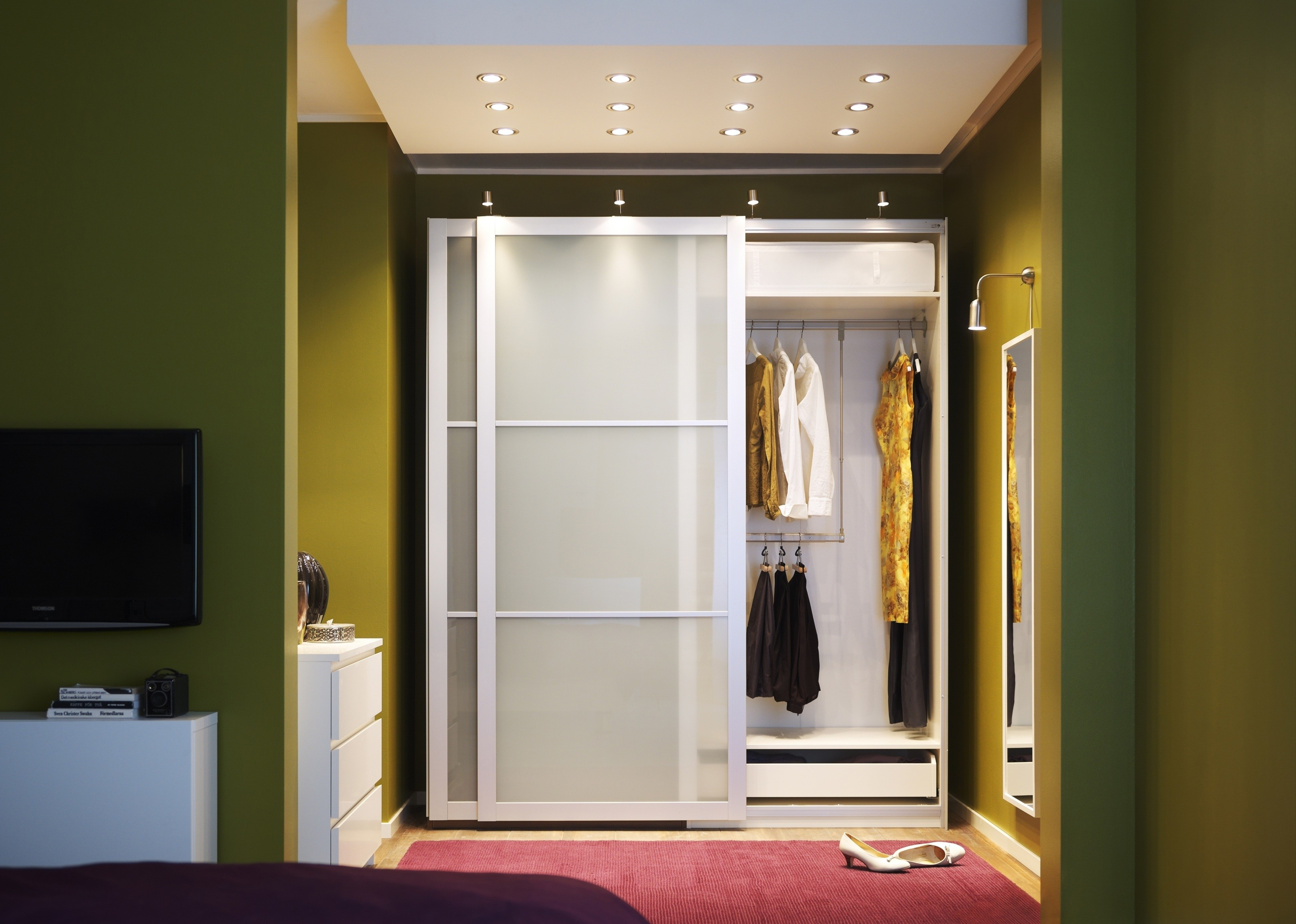 interior-frozen-glass-sliding-doors-with-white-wooden-frame-for-closet-placed-in-the-green-wall-room-sliding-closet-doors-for-bedrooms