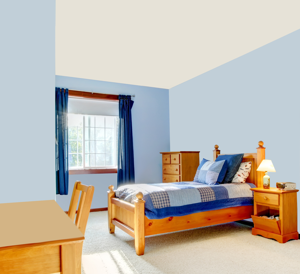 Blue boys room interior with wood bed and curtains.