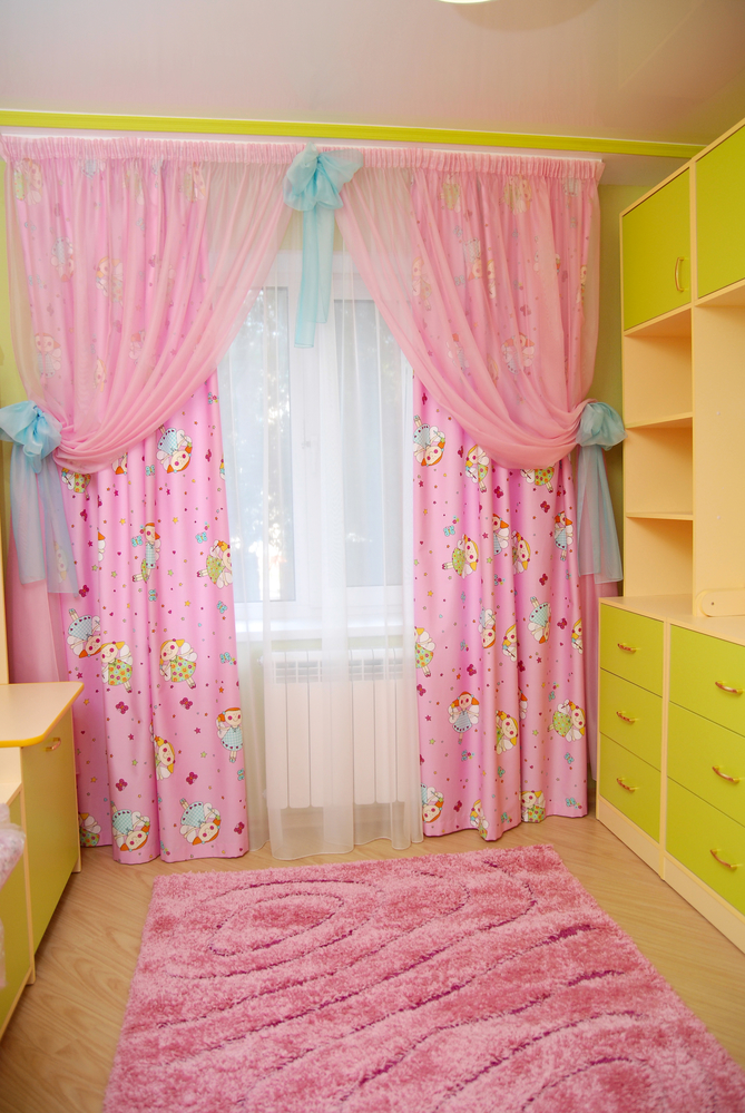 Pink curtains in a nursery.