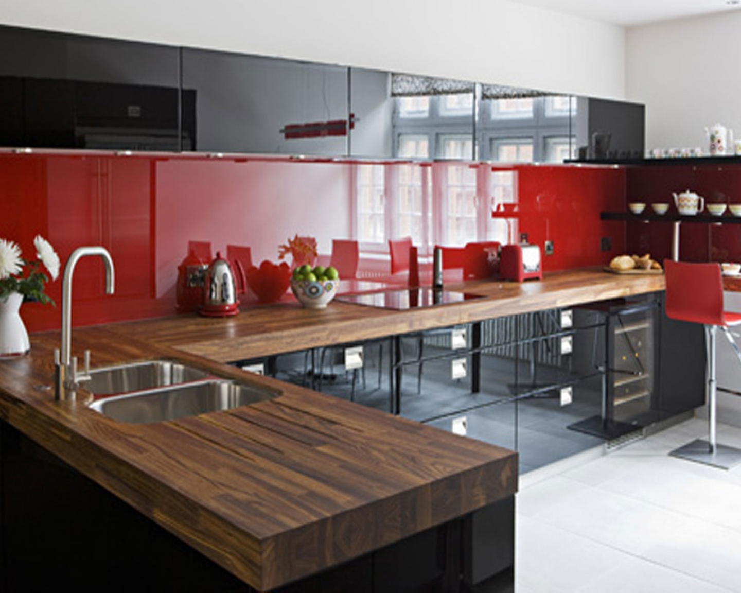 lovely-red-glass-backsplash-with-black-kitchen-cabinets-plus-stainless-steel-sinks