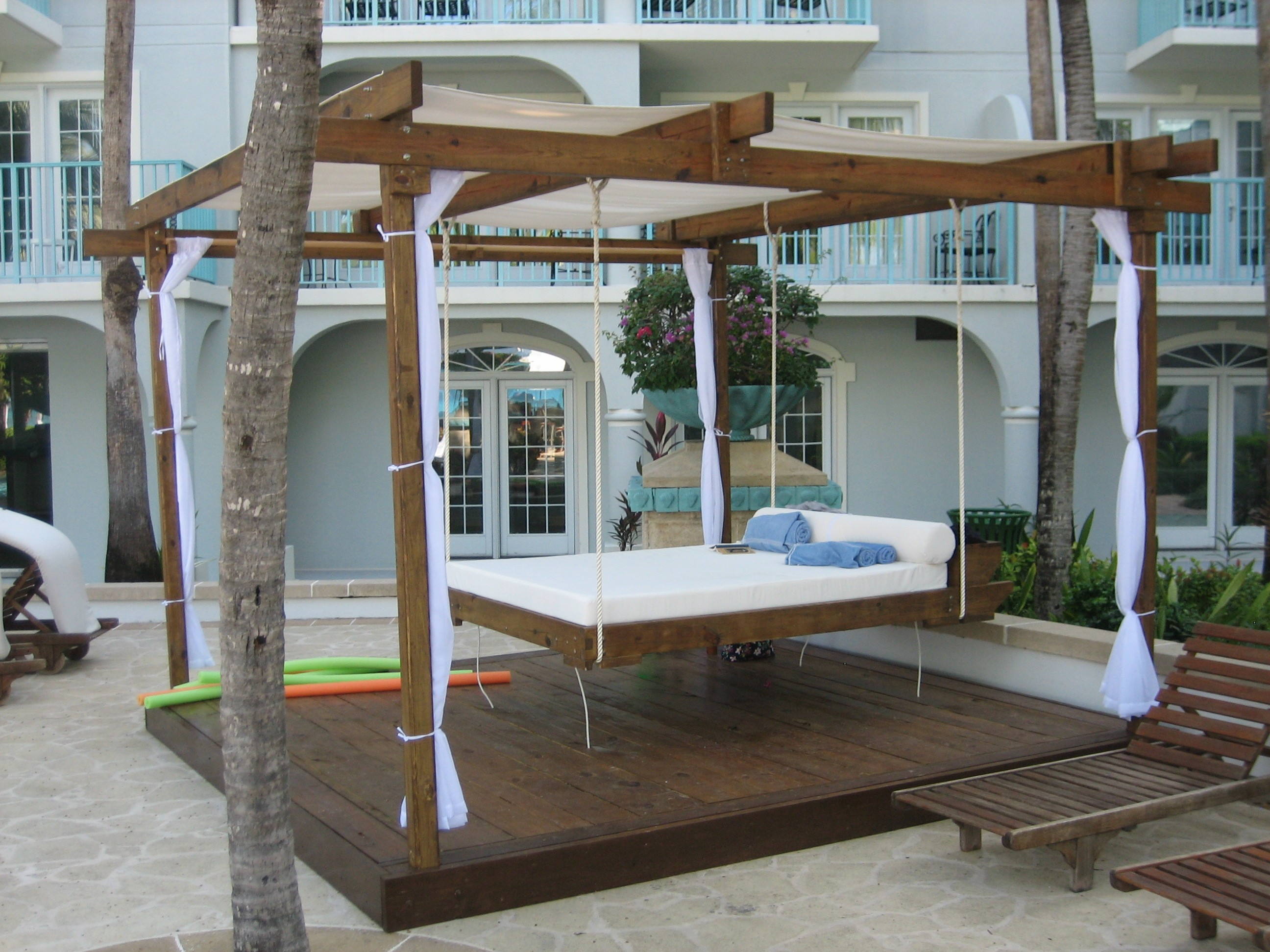 outdoor-hanging-beds-under-brown-teak-wood-pergola-deck-roof-decor-f-with-white-curtains_covered-pergola-on-deck_home-decor_shabby-chic-home-decor-discount-liquidators-target-office-diy-christmas-uniq