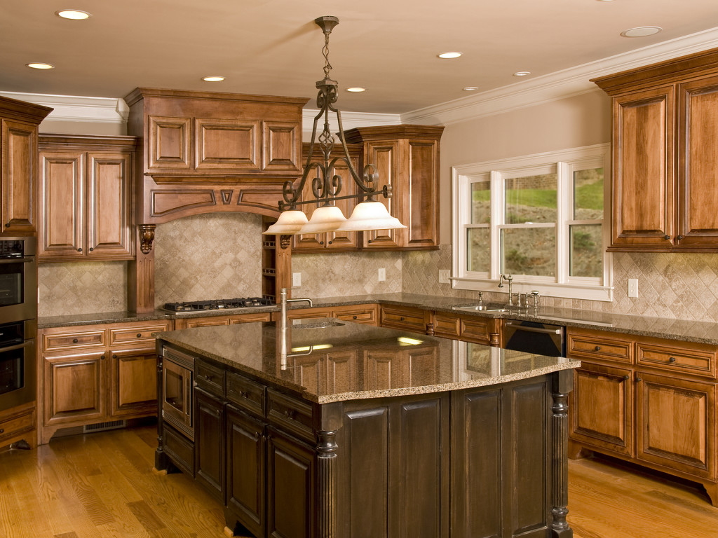 prepossessing-kitchen-island-with-sleek-granite-top-in-brown-tones-and-oak-wood-base-construction-with-sculpt-detail-as-well-as-ample-wooden-cabinets-ideas-granite-top-kitchen-island-kitchen-get-the-p