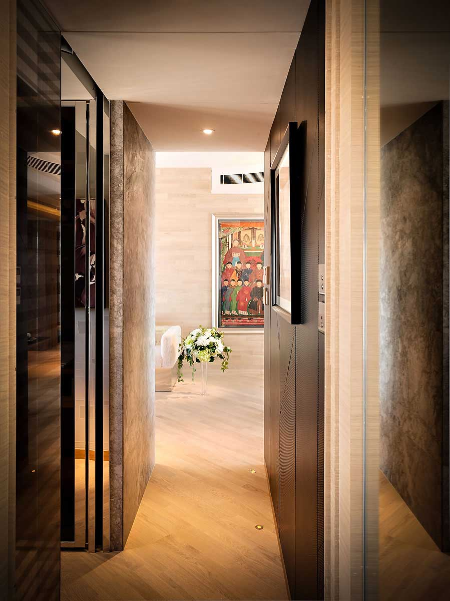 small-apartment-hallway-design-chic-uplight-on-wooden-floor-closed-nice-door-fit-to-hallway-designs-with-white-flowers-on-cute-planter-near-painting-on-wall