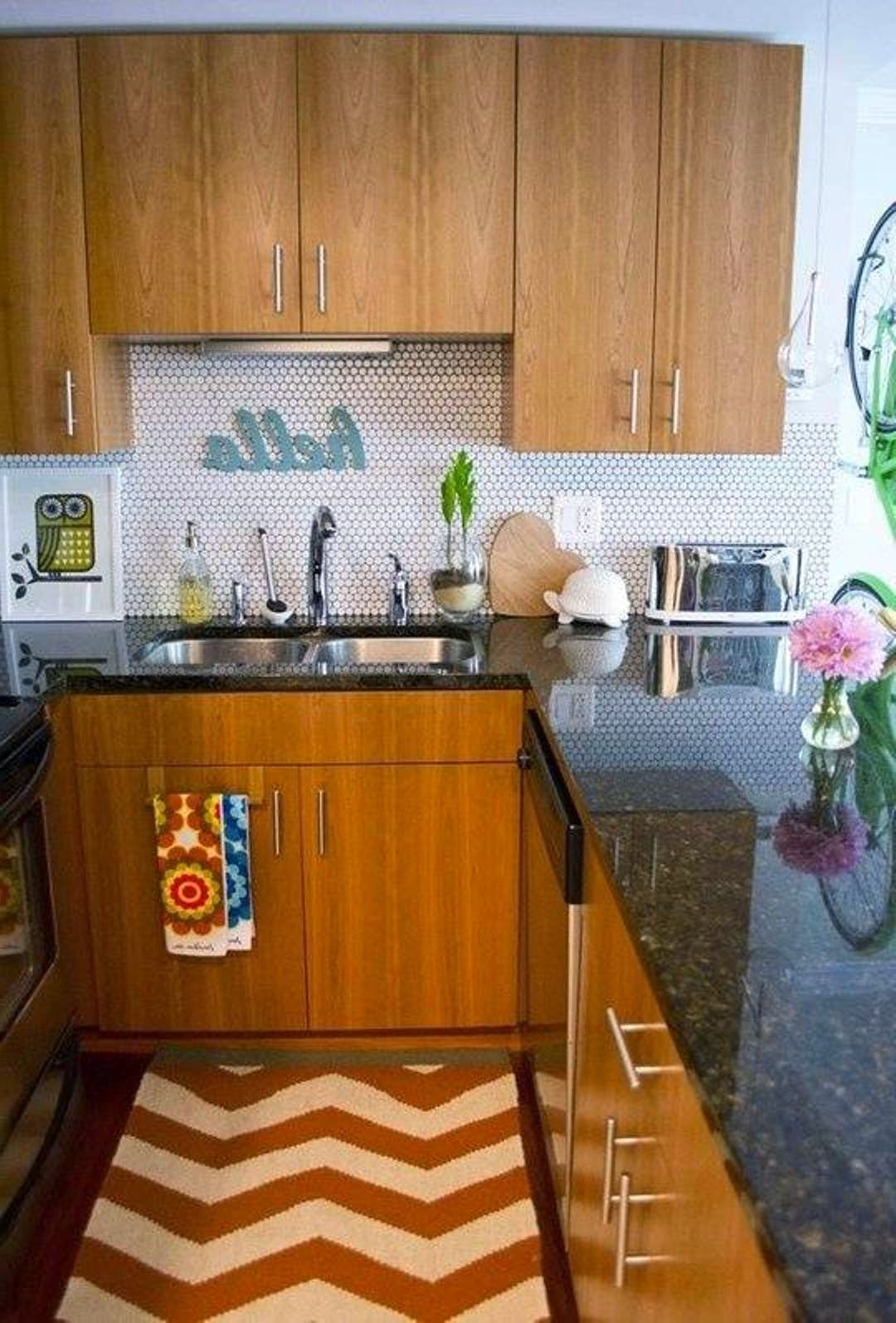 small-apartment-kitchen-presents-wooden-cabinets-with-brown-granite-countertop-also-chevron-area-rug-center