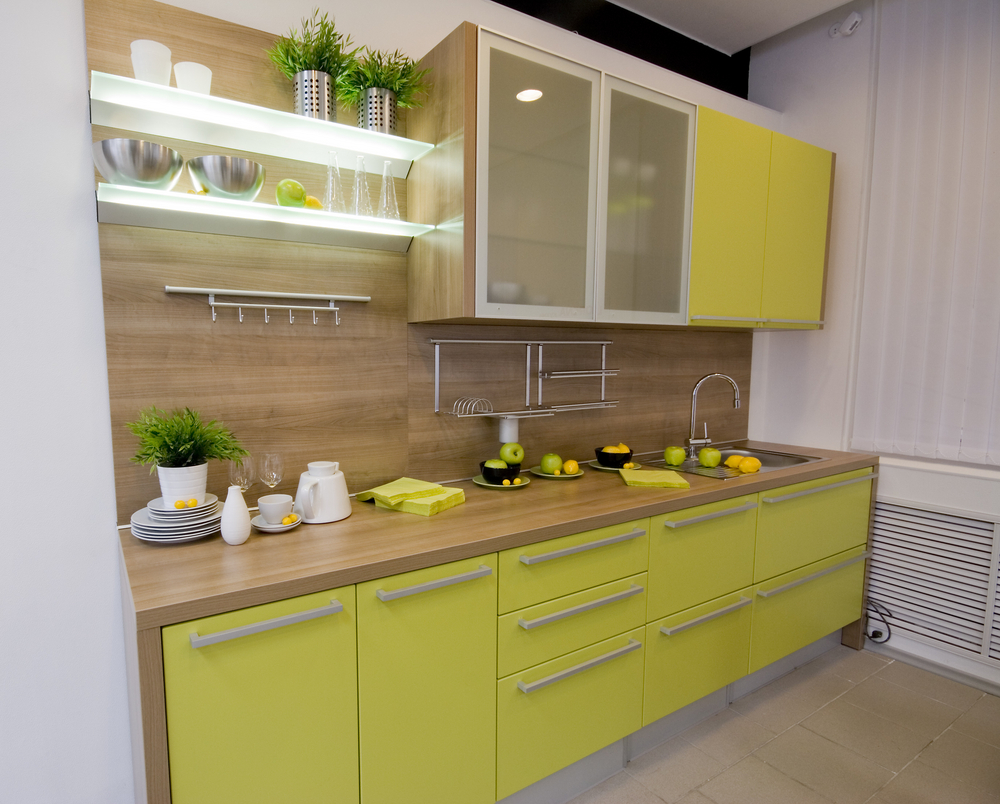 small-kitchen-design-presenting-yellow-green-finish-kitchen-cabinets-with-brushed-nickel-pull-handles-and-wooden-countertop-under-wall-kitchen-cabinets-using-frosted-glass-door