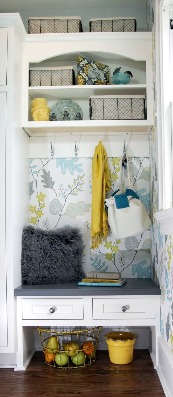 small-white-entryway-bench-below-wire-basket-with-liner-nearby-decorative-ceramic-plates-above-yellow-silk-scarf-by-stainless-steel-coat-hooks-600x1371
