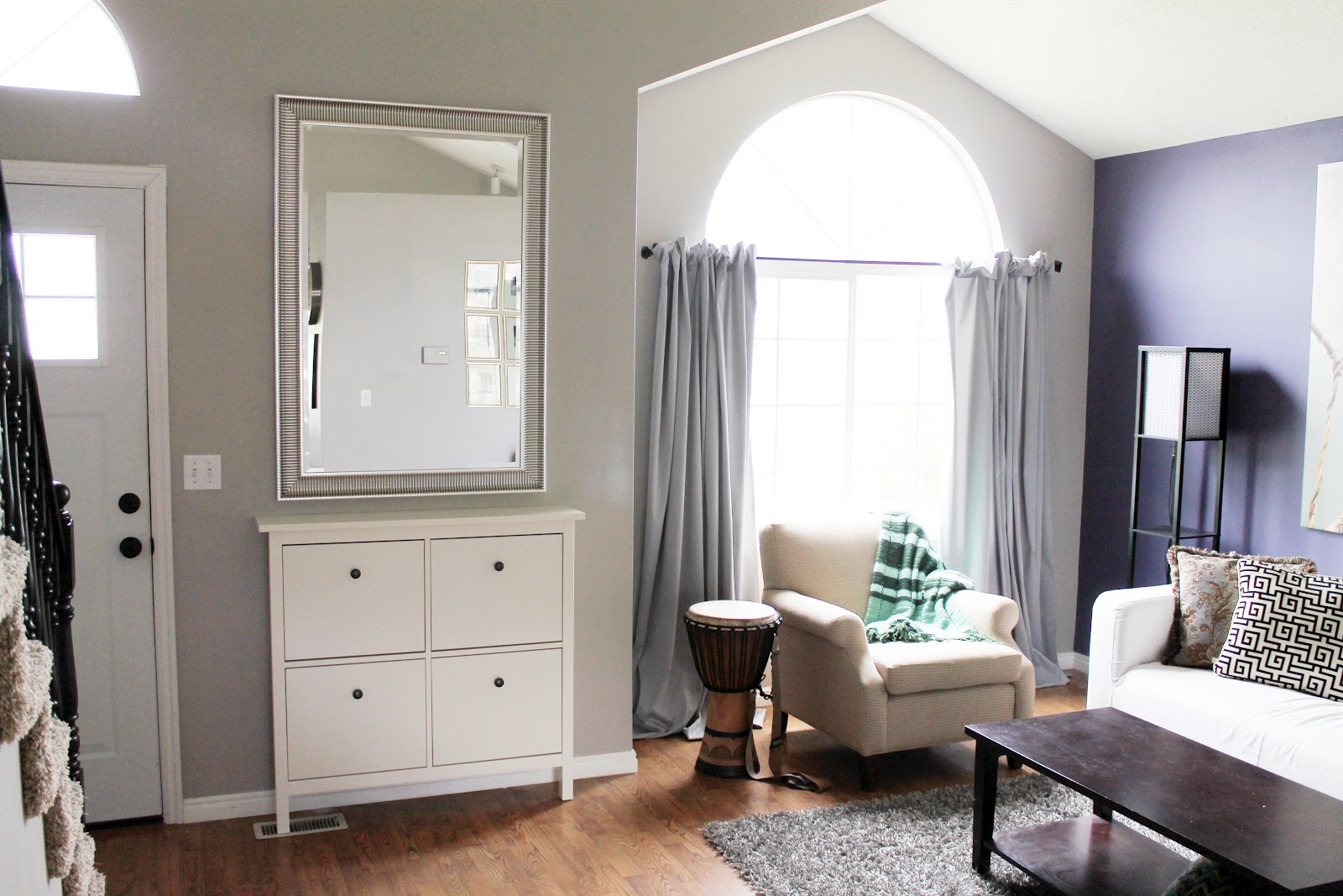 square-white-wooden-shoes-cabinet-for-entry-way-furniture-having-square-four-doors-on-laminate-flooring-under-rectangle-mirror-on-grey-wall
