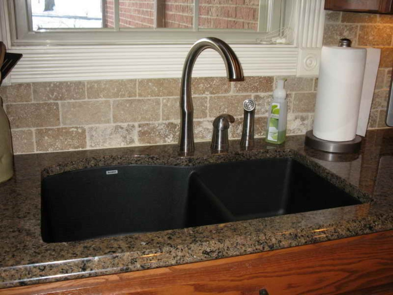 tissue-holder-on-elegant-granite-countertop-plus-subway-backsplash-tile-and-clever-black-kitchen-sink