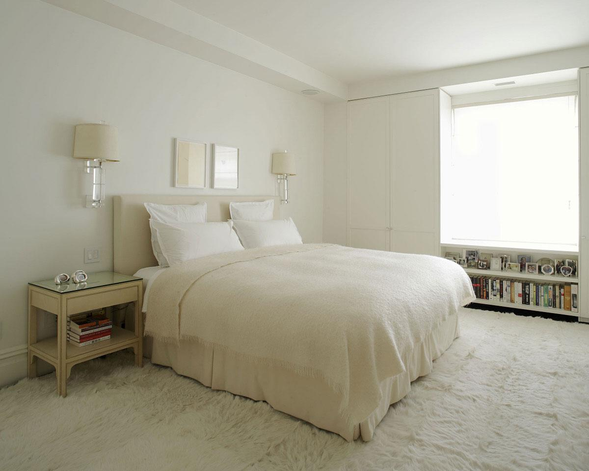 white-interior-color-bedroom-apartment-design-with-fur-rug-wooden-table-wall-bookshelf-and-wall-mounted-lamp-ideas-225821