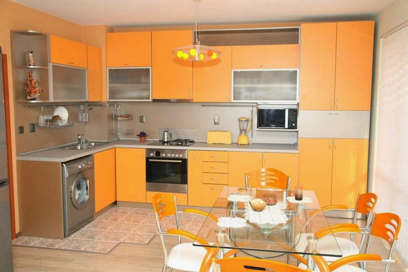 glamorous-orange-kitchen-cabinets-with-gray-backsplash-furnished-with-wooden-countertop-also-completed-with-breakfast-nook-with-rectangular-glass-table-and-orange-chairs-ideas