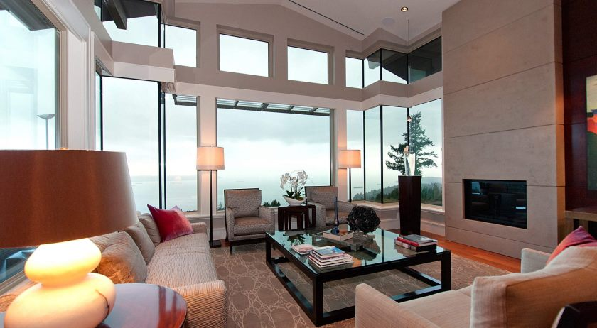 living-room-decoration-modern-glass-coffee-table-with-black-glass-top-design-interior-decoration-with-white-cream-sectional-sofa-and-awesome-lighting