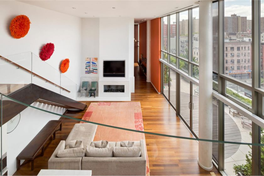 apartments-cute-red-fur-ornaments-on-wall-modern-bed-sofa-extraordinary-one-of-a-kind-downtown-penthouse-glass-door-fireplace-manhattan-apartment-with-chic-interior-de_extrior-decoration-of-pent-house