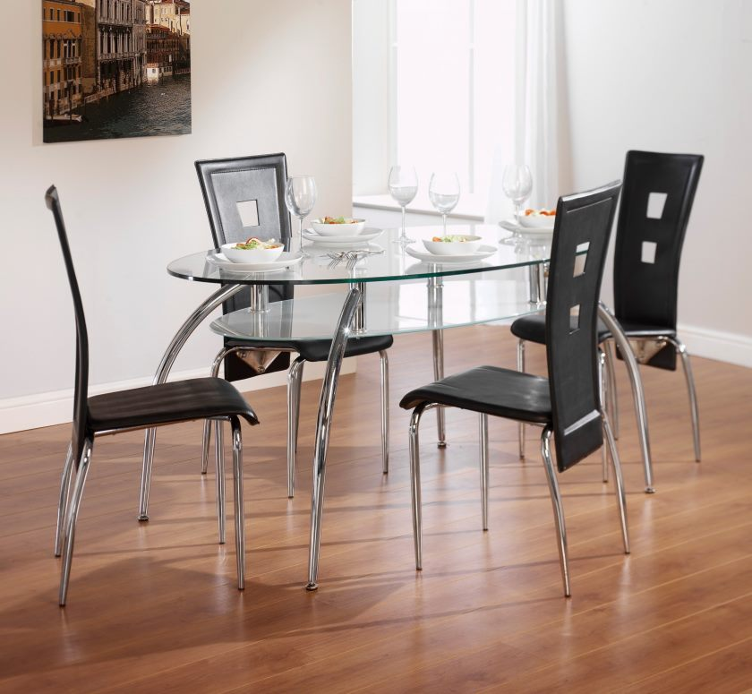 charming-restaurant-dining-furniture-set-ideas-for-small-spaces-presenting-oval-shape-glass-top-dining-table-with-stainless-steel-four-curved-legs-and-cool-black-vinyl-chairs-by-high-backrests-placed
